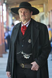 A Stoic Wyatt Earp of Helldorado. Tombstone, Arizona - October 22: Allen Street on October 22, 2011, in Tombstone, Arizona. A Helldorado participant dressed in Royalty Free Stock Images