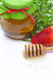 Stok aan hohey en kruik honing stock afbeelding