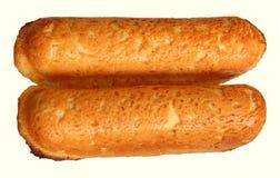 Stokbrood bij plaat op wit Royalty-vrije Stock Afbeeldingen