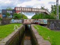 Bridge over a bridge over a canal lock. Stoke-on-Trent, Staffordshire, UK - MAY 17, 2015: Footbridge over a railwaybridge over a canal lock on the Trent and Royalty Free Stock Photography