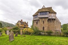 The North Tower, Stokesay Castle, Shropshire, England. Stokesay Castle`s North Tower that was built in the late 13th century and to the left, the stunning 17th Royalty Free Stock Photography