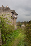 Stokesay Castle in Shropshire on cloudy day. Moat around Stokesay castle on a dark cloudy day Royalty Free Stock Photos