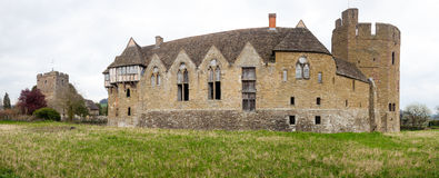 Stokesay Castle in Shropshire on cloudy day. Panoramic view of Stokesay castle with the parish church on cloudy day Stock Photography