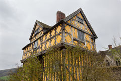 Stokesay Castle in Shropshire on cloudy day. Gatehouse entrance to Stokesay castle on a dark cloudy day Royalty Free Stock Image