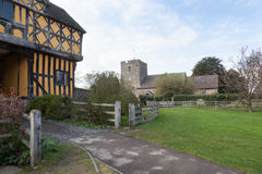 Stokesay Castle in Shropshire on cloudy day. Parish church by gatehouse to Stokesay castle in Shropshire Royalty Free Stock Image