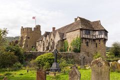 Stokesay Castle, Shropshire, England. The North Tower, Great Hall and South Tower with the raised English Heritage Flag flying in the wind as seen from the Stock Images