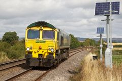 Light engine movement for freight loco. STOKESAY, UK - AUGUST 25: A class 66 diesel locomotive operated by Freightliner heads towards South Wales on a light Stock Photography