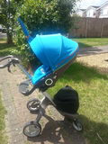 Stokke Xplory. In Urban Blue with matching parasol Royalty Free Stock Image