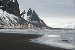 Stokksnes Peninsula landscape, Vestrahorn mountains and black sand ocean coast line, Iceland Stock Photo