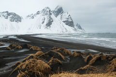 Stokksnes Peninsula, Vestrahorn mountains and black sand dunes over the ocean, Iceland Royalty Free Stock Photos