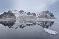 Stokksnes. Reflections in the morning, Southeast Iceland Royalty Free Stock Image