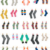 Stoks. Vector Cute Pattern With A Variety Of Socks That Are Washed And Dried On A Rope. Packaging design, textile design. White background Stock Images