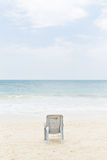 Stol på stranden Arkivfoto