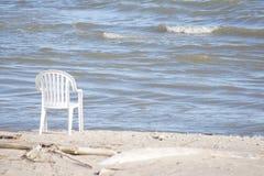 Stol på stranden Arkivbild