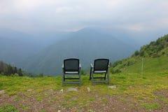 Stolar framme av berget Fotografering för Bildbyråer