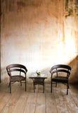 Stolar framme av en gammal vägg Royaltyfria Bilder