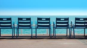 Stolar framme av havet Fotografering för Bildbyråer
