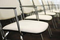 Stolar i en konferens Hall Royaltyfria Foton