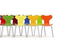 Stolar med färgar begrepp Arkivbilder
