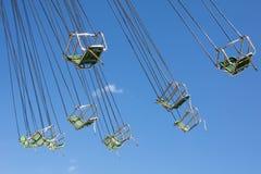 Stolar med kedjor av den klassiska karusellen Royaltyfria Foton