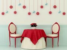 Stolar och en tabell med julpynt Fotografering för Bildbyråer