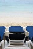 Stolar på stranden royaltyfria bilder