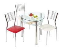 stolar som äter middag den glass tabellen Royaltyfri Foto
