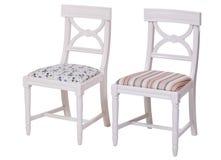 stolar som äter middag elegantt som isoleras över white två fotografering för bildbyråer