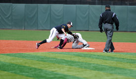Stolen base attempt - college baseball Royalty Free Stock Images