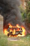Stolen car on fire Stock Image