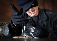 Stolen loot. Burglar with his hands full of jewellery, shining with a torch stock image