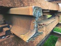 Stolen rail. Detail of autogen torch  cut rail rod on concrete sleeper. Repair of tramway. Stock Photo