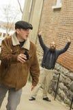 Stolen Wallet. Hoodlum steals wallet from balding bearded business man Stock Photography