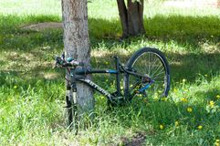 Stolen wheel and seat on locked bicycle royalty free stock image