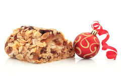 Stollen Cake and Christmas Bauble Royalty Free Stock Photos