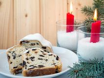 Stollen, Christmas tree and red burning candles Stock Image