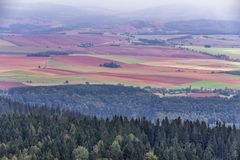 Stolowe Mountains in Poland. Patchwork fields seen from Szczeliniec Wielki massif in Table Mountains National Park, Sudetes in Poland Royalty Free Stock Image