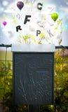 Stolpeask med färgrika bokstäver Arkivbilder