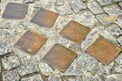 Stolpersteine: Street Memorials for Holocaust Victims. Five Cobblestone-sized Memorials for Individual Victims of Nazi Terror, in front of a House in Berlin Royalty Free Stock Photography
