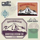 Stolpestämpeluppsättning med Grossglockneren, Österrike royaltyfri illustrationer