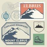 Stolpestämpeluppsättning med Mountet Elbrus stock illustrationer