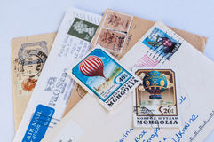 Stolpestämplar och gamla bokstäver Fotografering för Bildbyråer