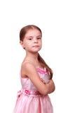 Stolze kleine Dame in einem rosafarbenen Kleid Lizenzfreies Stockfoto