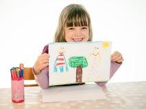 Stolzes Mädchen zeigt sein Bild Stockfotografie