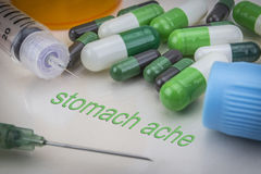 Stomach ache, medicines and syringes as concept. Of ordinary treatment health Stock Photos
