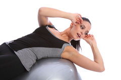 Stomach crunches by fit woman on exercise ball Stock Photography