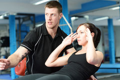 Stomach crunches with personal trainer royalty free stock image