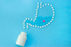 Stomach made of white pills with some red and blue pills inside royalty free stock image