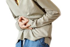 Stomach pain. Boy holding hands on his stomach over white background, pain Stock Images
