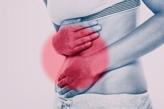 Free Stomach Pain Woman With Red Circle Targeting Painful Area On Lower Abdomen Body. Medical Issue Of Gut Health Or Crohn`s Stock Photos - 193900863